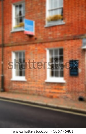 The blurry photo of building selling advertising signage represent the accommodation selling business and real estate concept related idea.  - stock photo