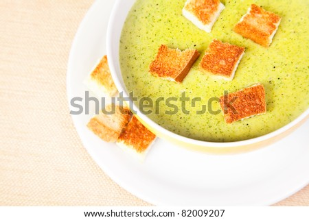 The bowl of broccoli soup with croutons