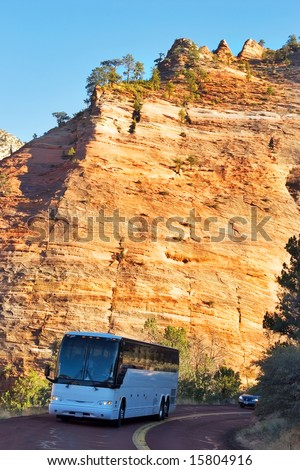 The bus with tourists on highway in National park Yosemite in the USA - stock photo