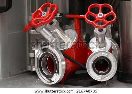 The close-up of hydrant and water hoses - stock photo