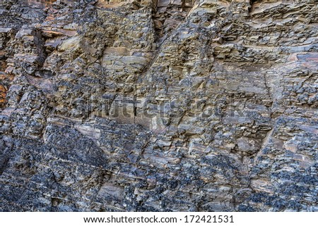 The close-up relief of the rocks with a layered structure.   - stock photo
