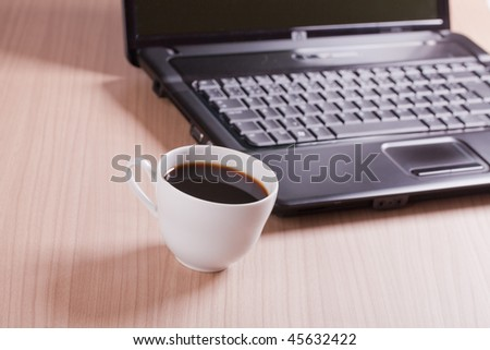 the coffee cup and computer - break in office