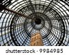 The cone-shaped, metal-framed glass ceiling of an inner-city Melbourne shopping centre. - stock photo