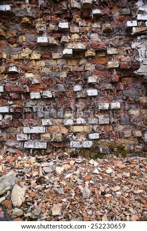 the destroyed brick wall photographed by a close up old - stock photo