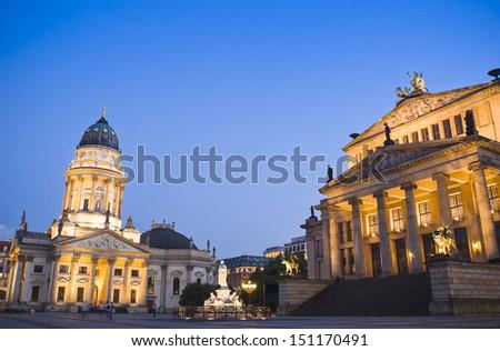 The Deutscher (1785) and the Franzosischer Dom (1701) reside with Das Konzerthaus (1821) theatre in this beautiful area of Berlin. - stock photo