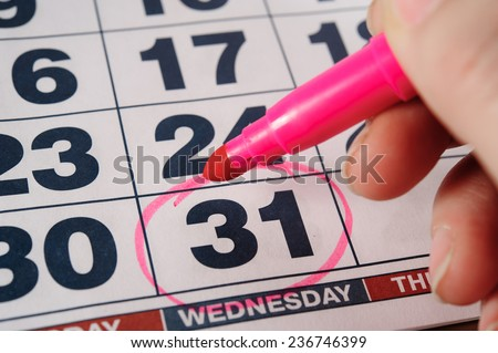 the eve of the new 2015 on the calendar, December 31, 2014 on the circle the pink marker - stock photo