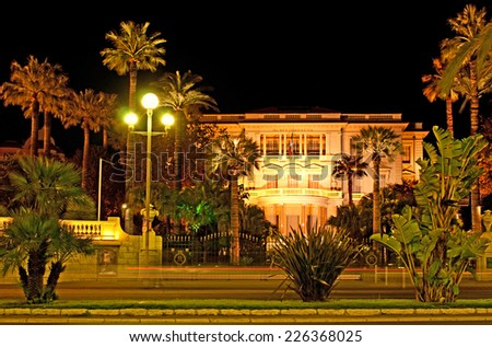 The evening view on the Villa Massena, the fine arts museum, built in the Belle Epoque, located on the Promenade des Anglais, Nice, France. - stock photo