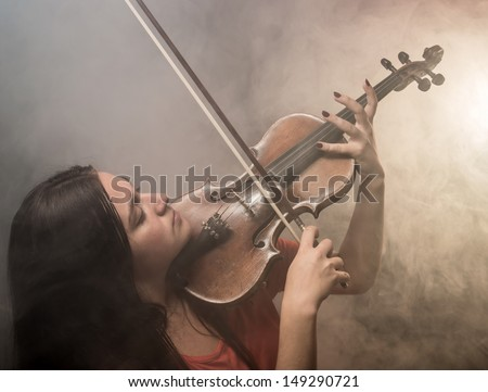 The girl plays on a violin - stock photo