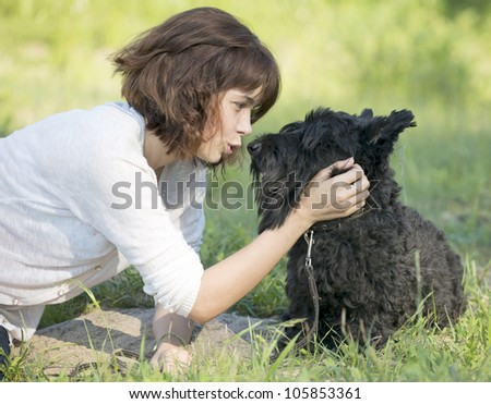 The girl talks to a dog - stock photo