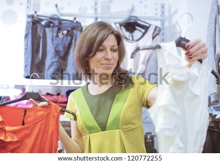The in shop tries on clothes - stock photo