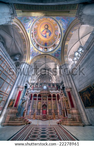 The interior and ceiling fresco of Jesus in the temple of the Holy Sepulcher. - stock photo