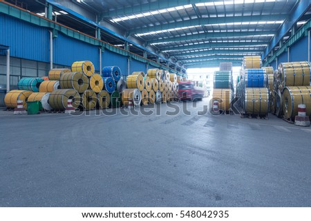 The interior of a steel mill coil warehouse
