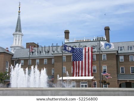 the largest  American flag ever seen standing in front of the city hall  in Alexandria city, Virginia Va, USA - stock photo