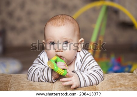 the little boy gnawing the special adaptation - stock photo