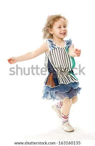 The little girl runs - stock photo