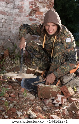 The man with sensor in ruins - stock photo