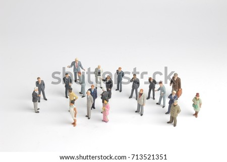 the mini model group of investor standing together isolated