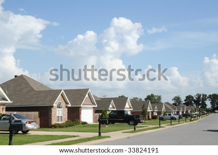 """The Neighborhood"" - Subdivision of fairly new like houses. - stock photo"