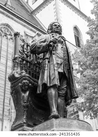 The Neues Bach Denkmal meaning new Bach monument stands since 1908 in front of the St Thomas Kirche church where Johann Sebastian Bach is buried in Leipzig Germany. Black and white image. - stock photo
