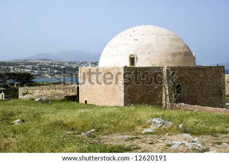 """The Ottoman mosque is a square building  with a massive dome. Venetian fortress built in 1590 in Rethymnon, Crete"""
