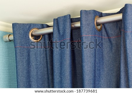 The part of Denim  curtains  with ring-top rail - stock photo