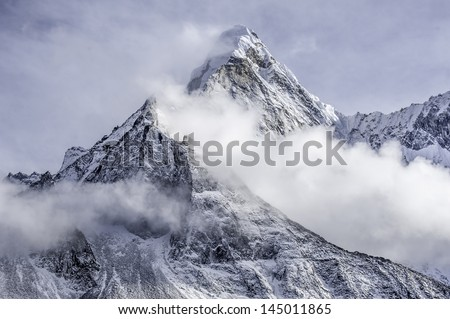 the peak of the Ama Dablam massif - Everest region, Nepal Himalayas - stock photo