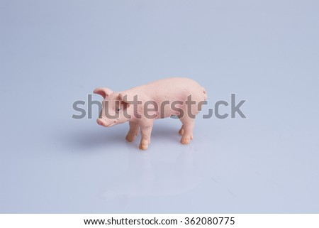 """""""The Pig"""" A plastic pig toy in a neutral background - stock photo"""