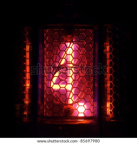 The real Nixie tube indicator of the numbers of retro style. Indicator glow with a magical purple fringing. Digit 4 and the point - stock photo