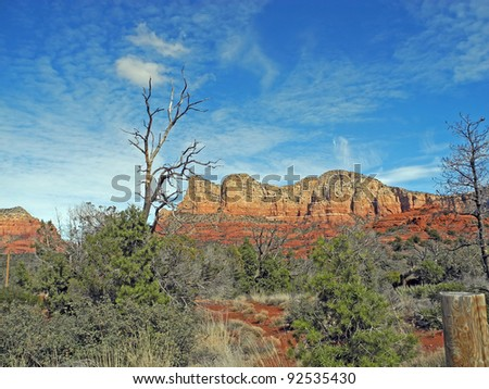 The rugged landscape around scenic Sedona, Arizona, offers lush trees and brush and dramatic, red-rock mesas, cliffs and monuments. - stock photo