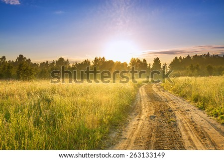 the rural landscape with sunrise  and the road - stock photo