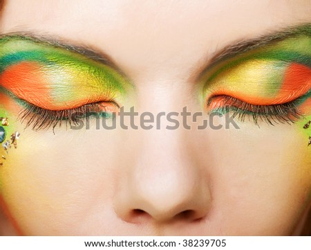 The sensual eyes , beautiful make up and bright colore - stock photo