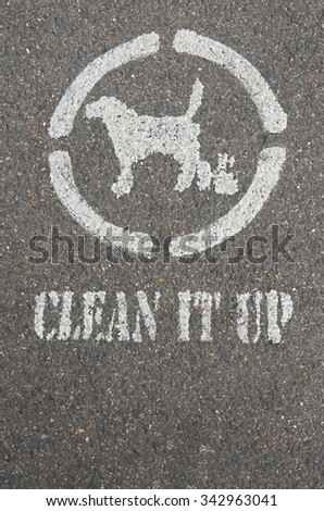"the sign ""clean it up"" at the footpath - stock photo"