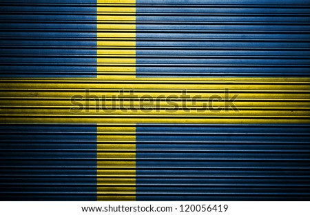 The Swedish flag painted on metal - stock photo