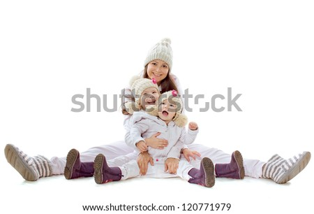 The woman and two little girls sit on a white background - stock photo