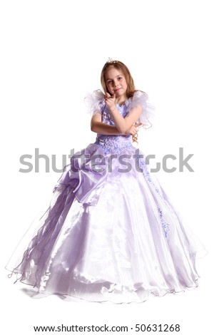 The young fine girl (child) shows the ball dress
