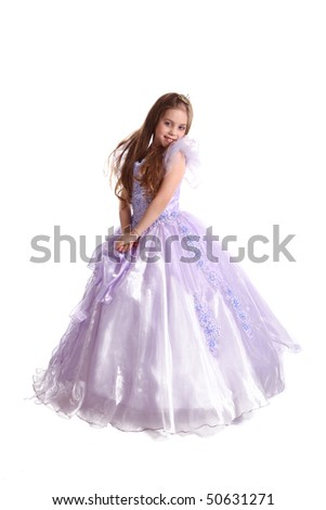 The young fine girl (child) shows the ball dress - stock photo