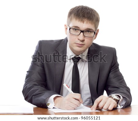 The young man signs the document - stock photo