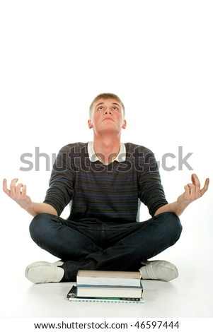 The young student meditates on books. - stock photo
