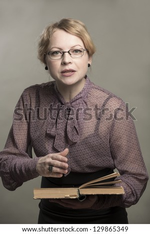 The young woman reads the book - stock photo