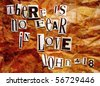 """There is no fear in love"" John 4:18 - written in ransom letters layered with textures of wrinkled paper bag and slate - stock photo"