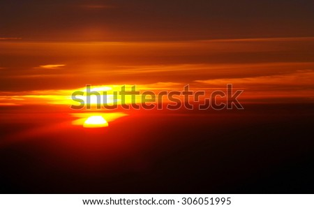 Thin line between day and night, photo taken from airplane Twilight- the time between darkness and sunrise in the morning, and sunset and complete darkness in the evening - stock photo