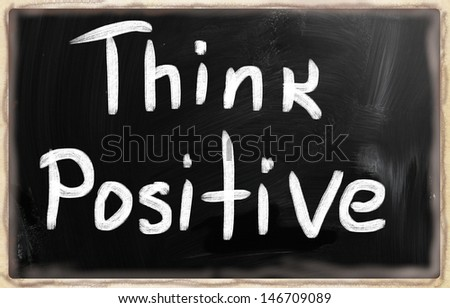 """Think positive"" handwritten with white chalk on a blackboard."