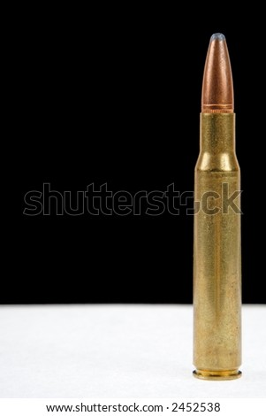 "30-06 ""thirty aught six"" high power rifle ammunition on white and black - stock photo"