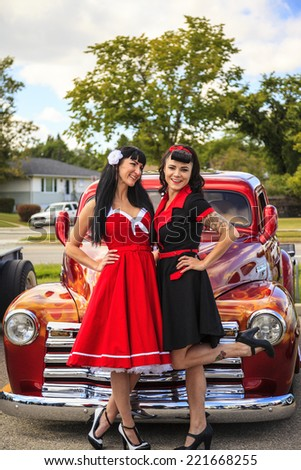 "THORNCLIFF CALGARY CANADA, SEPT 13 2014: The annual Show and Shine with Pin Up Girls  ""Cars before 1964""   - stock photo"