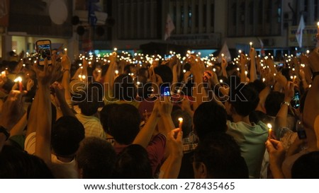 thousands of people holding candle light - stock photo