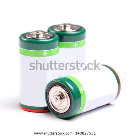 Three batteries on white - stock photo