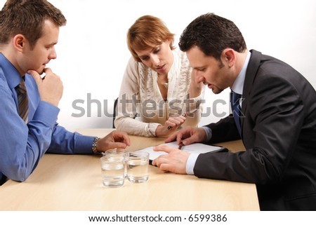 three business people talking about contract - stock photo