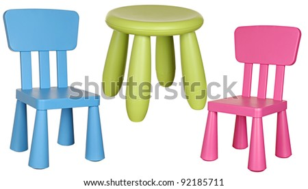 Three children's plastic chairs isolated on a white background: green, pink and blue.