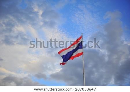 Three colors Thailand flag  on blue sky.  - stock photo