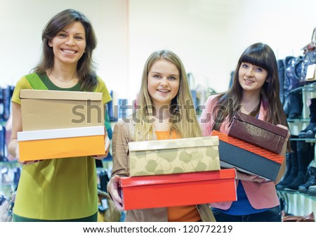 Three girls with boxes - stock photo